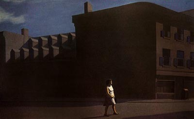 A lone women is silhouetted against a brown factory building